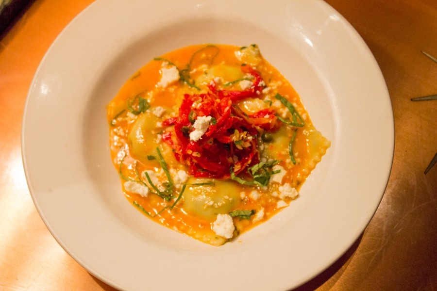 Hand-crafted Spinach and Artichoke Ravioli: Roasted red pepper beurre // Sun-dried tomato and caper relish // Crumbled Feta