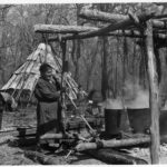 Native American making Maple Syrup
